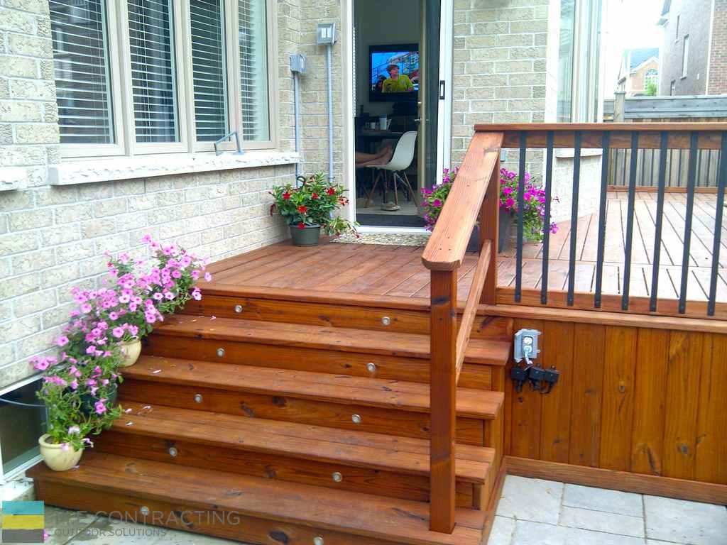 IPE deck, aluminum railing with IPE frame, landscaping, outdoor furniture