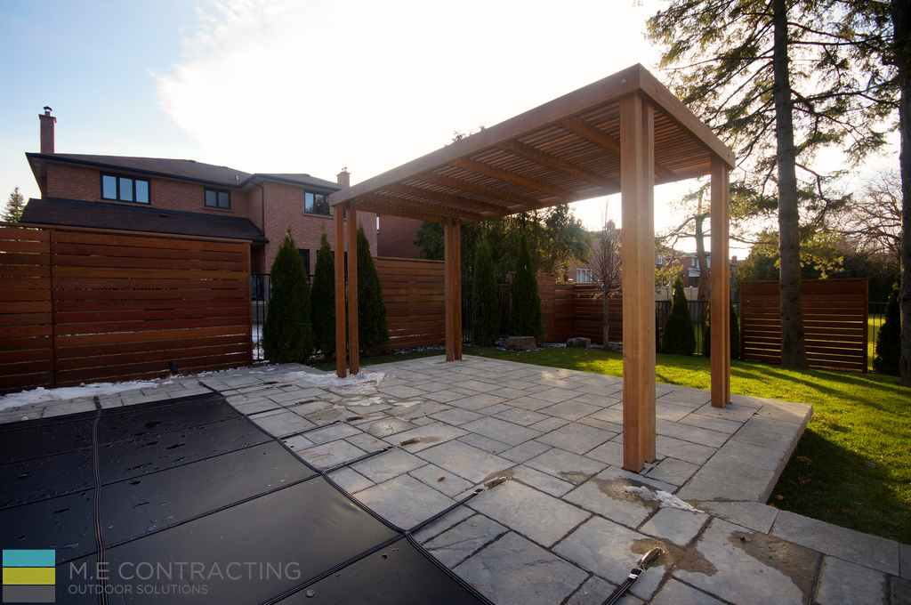 Landscaping, stone pebbles with cedar foot bridge, interlocking stone patio, fiberglass pool with cover, cedar deck, privacy screen, pergola, M.E. Contracting