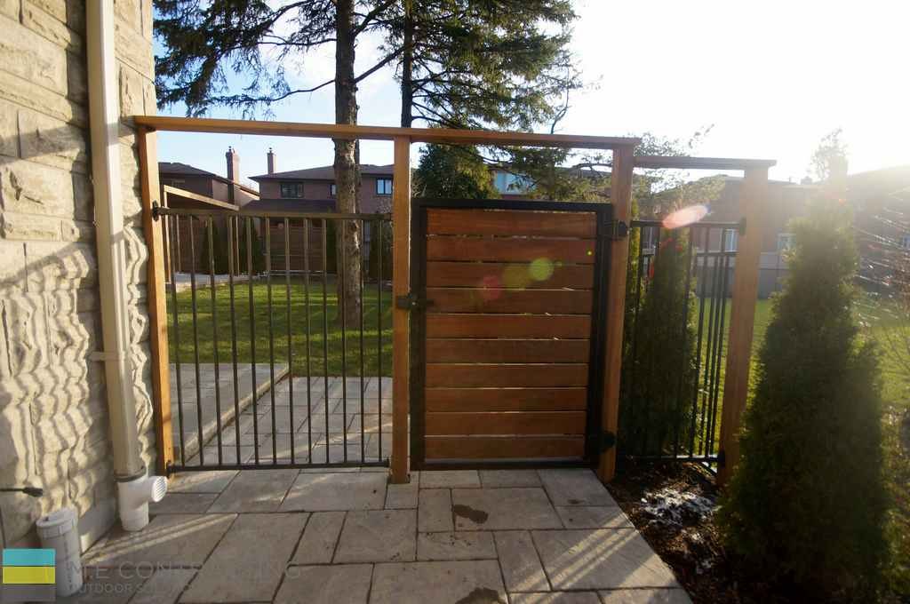 Interlocking, walkway, aluminum fence with cedar frame and gate, landscaping