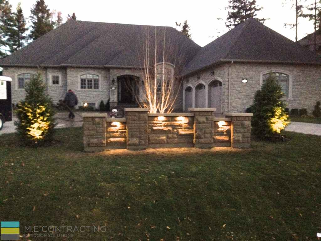 Landscaping, retaining wall, interlocking driveway, lighting, coping flagstone