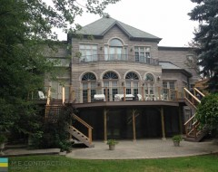 Landscaping, interlocking stone patio, PVC deck and steps with aluminum railings and cedar posts, basement walkout