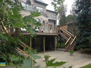 Landscaping, interlocking stone patio, PVC deck with aluminum railings and cedar posts, basement walkout, cedar privacy screen