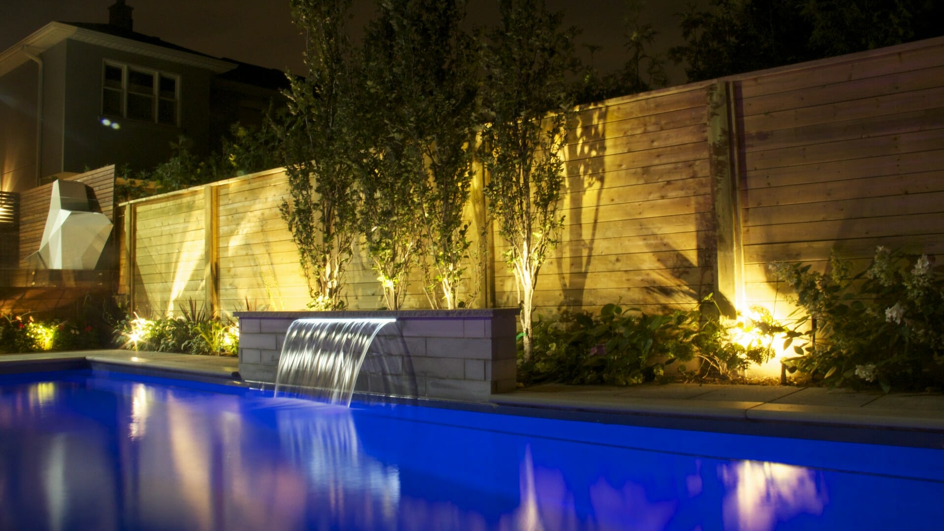 Fiberglass pool, water feature, cedar fence, landscaping, PVC deck, privacy screen, coping stone,