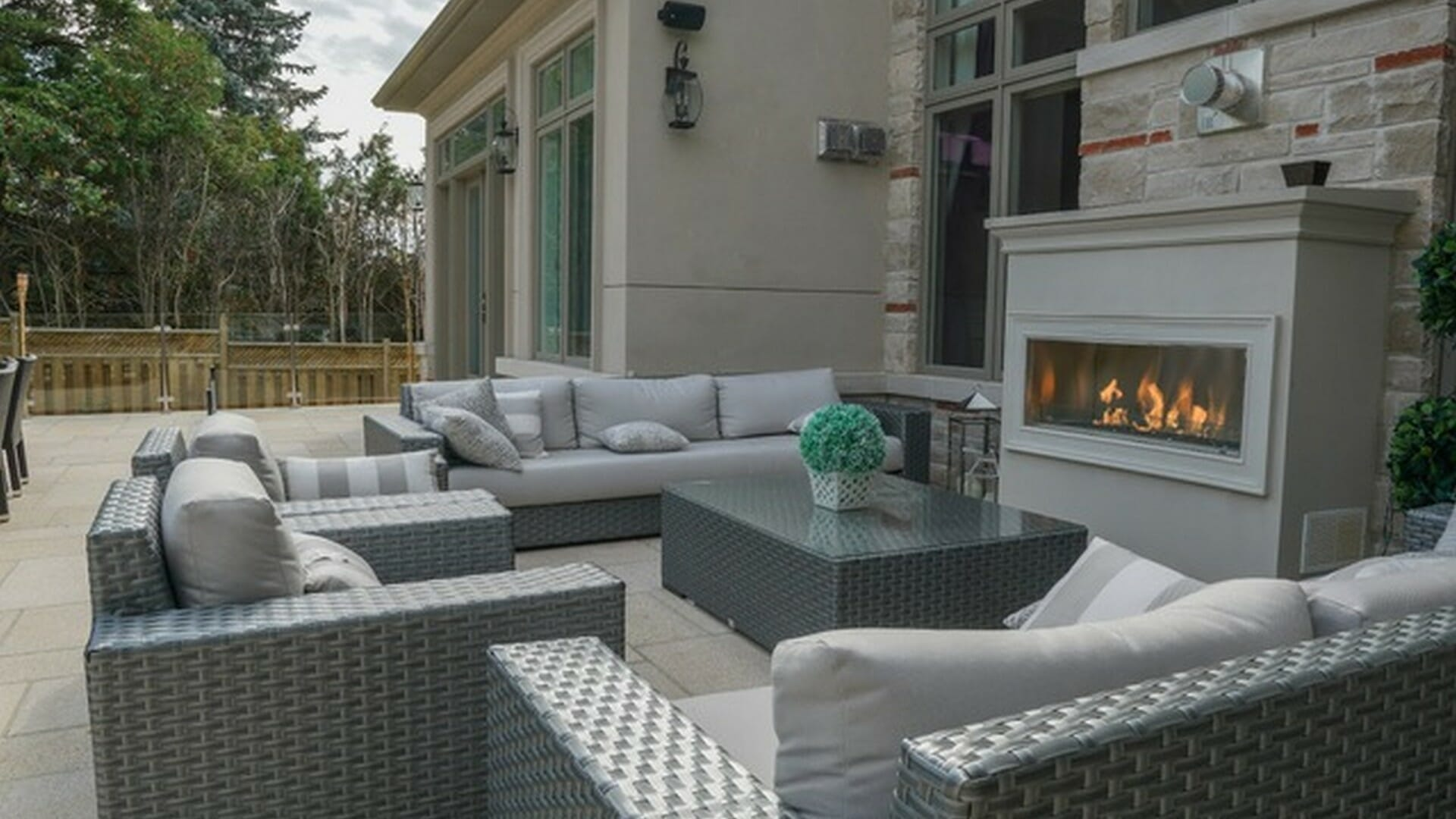 Fireplace, stone veneer, interlocking, tempered glass railings, outdoor furniture, stone deck