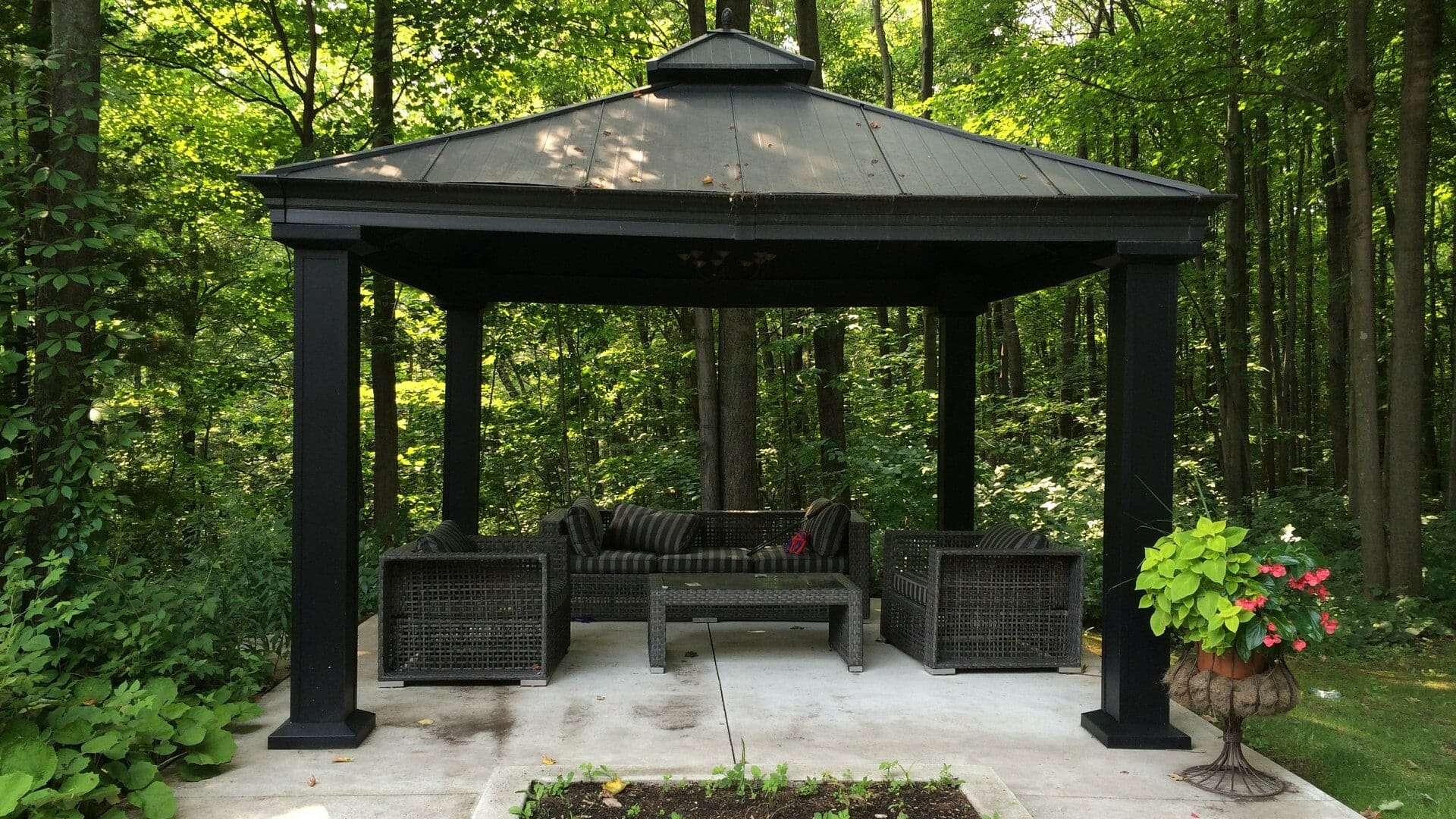 Aluminum pergola, interlocking stone patio, outdoor furniture, landscaping