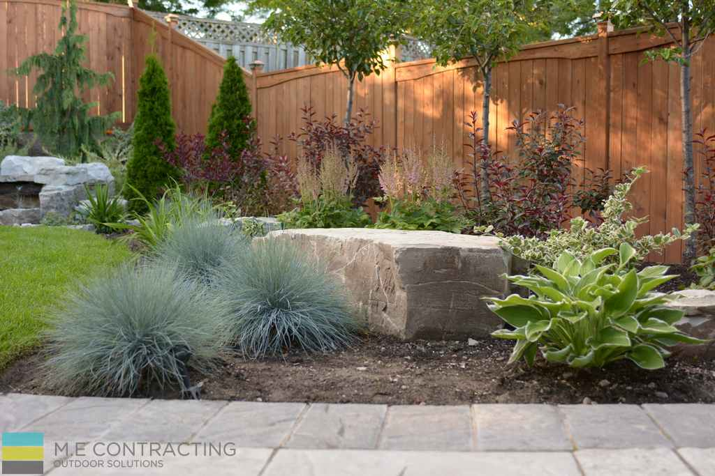 Interlocking, armor stone, cedar fence. garden, landscaping