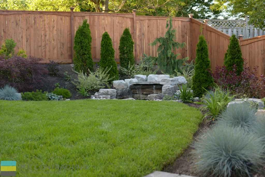 Cedar fence, landscaping, armor stone, garden,