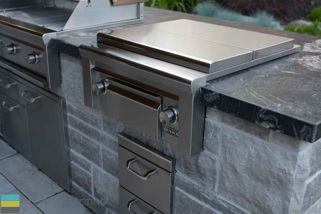 Outdoor kitchen, stainless steel, coping flagstone counter,interlocking