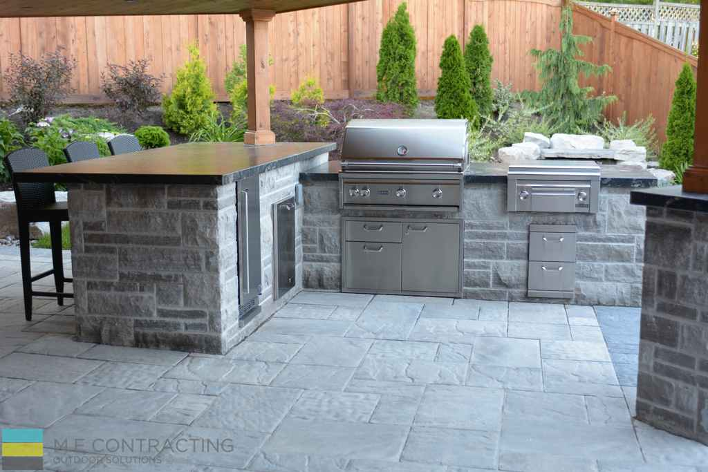 Outdoor kitchen, coping flagstone counter top, interlocking, cedar fence