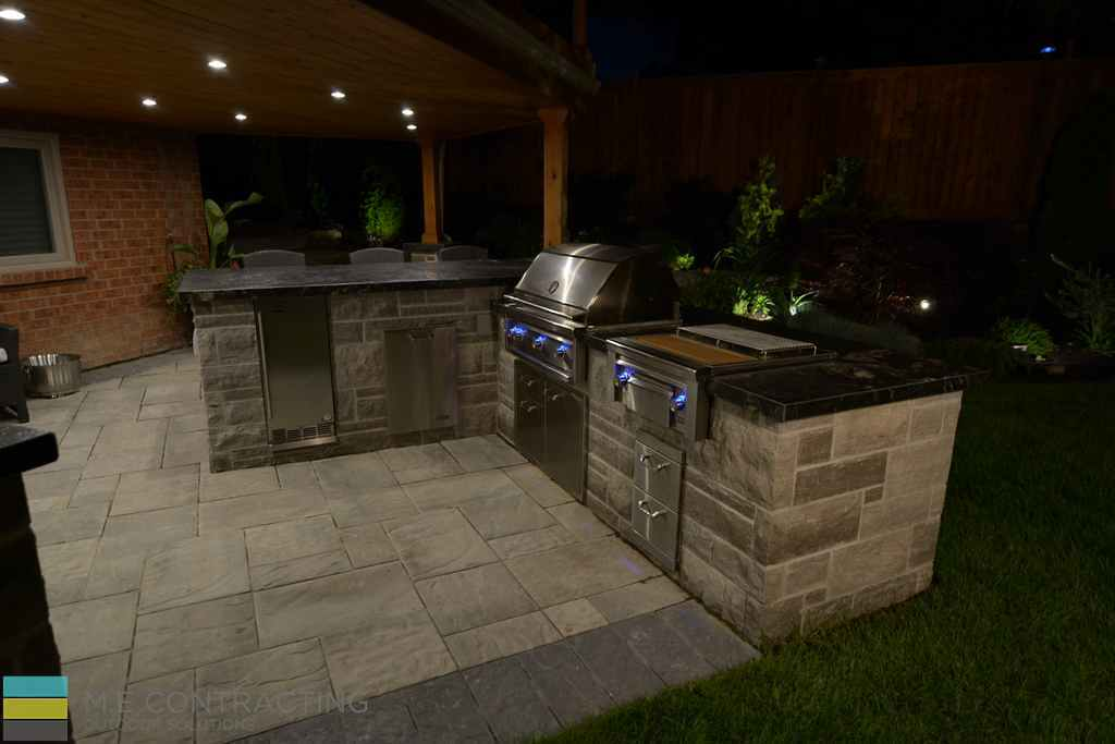 Interlocking patio, outdoor kitchen, coping flagstone counter top, landscaping, cedar deck