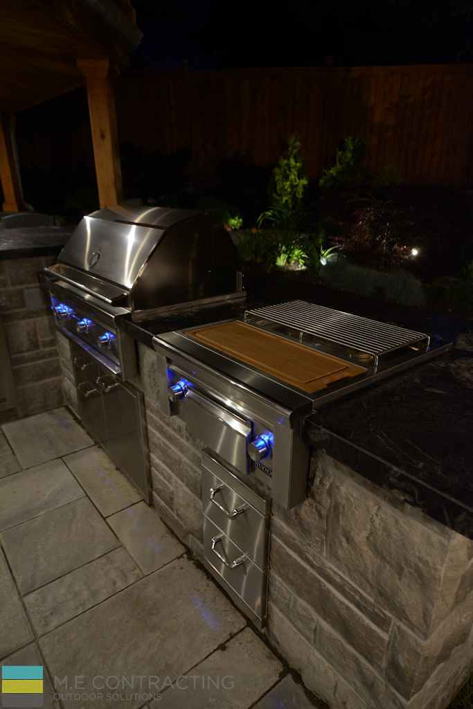 Interlocking patio, outdoor kitchen, coping flagstone counter top, landscaping