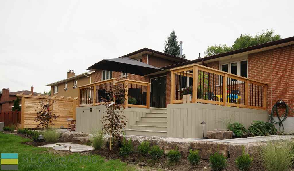 PVC deck, aluminum railing with wood frame, outdoor patio, with storage and skirt, interlocking walkway, landscaping