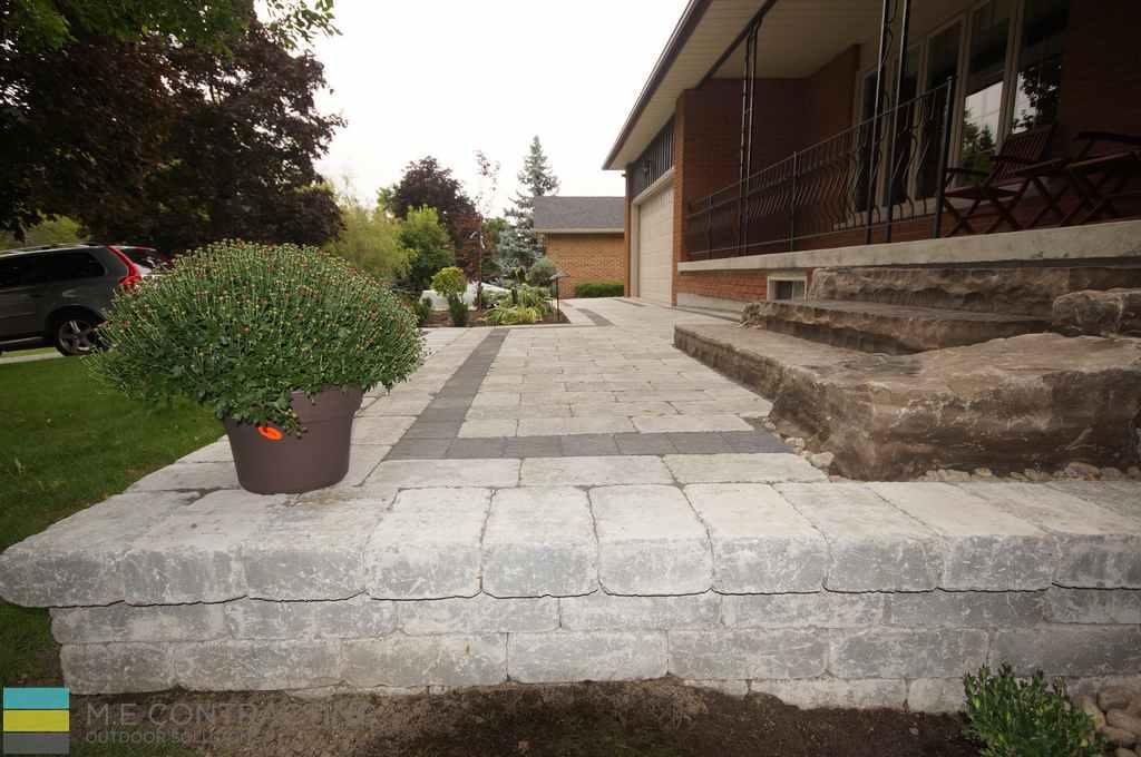 interlocking raised walkway, armor stone, landscaping, stone porch
