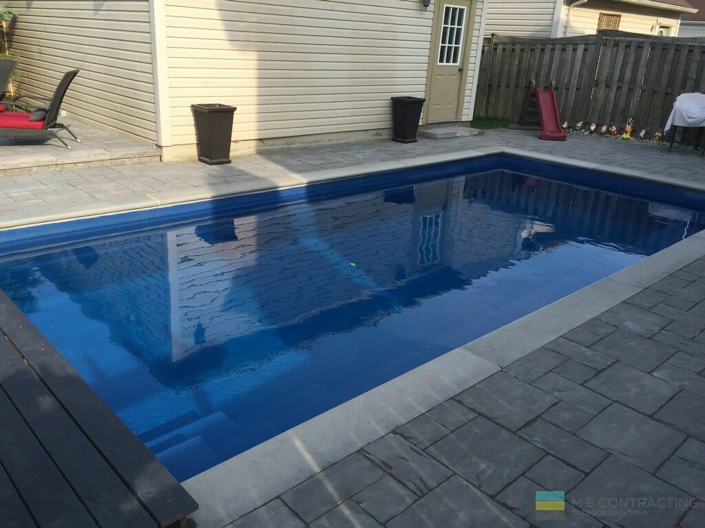 Fiberglass pool and interlocking stone