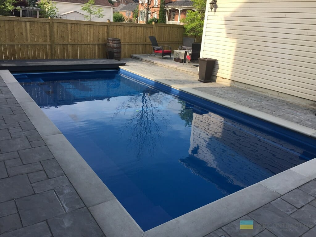 Fiberglass pool with interlocking stone patio