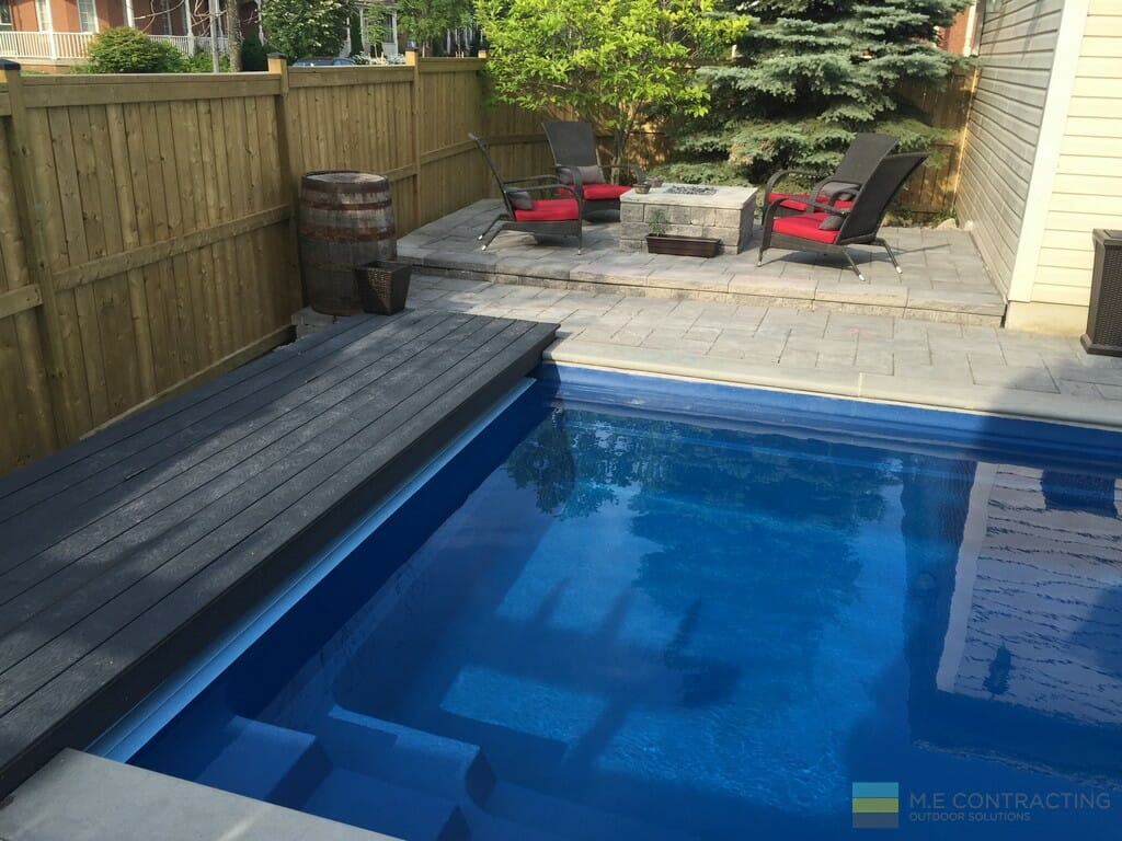 Pool with PVC walkway, interlocking patio and landscaping