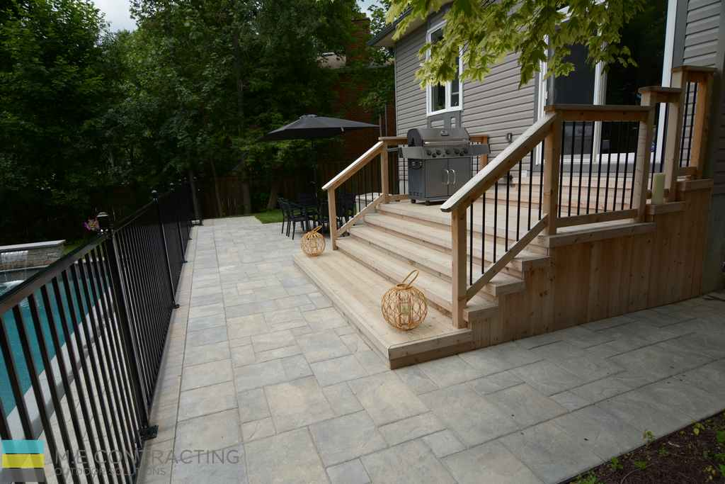 Fiberglass pool, aluminum railings, interlocking stone walkway, cedar deck with skirt, landscaping, cedar deck