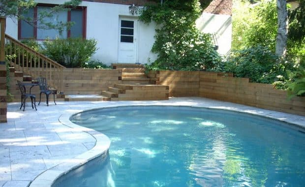Landscaping design with deck and retaining walls