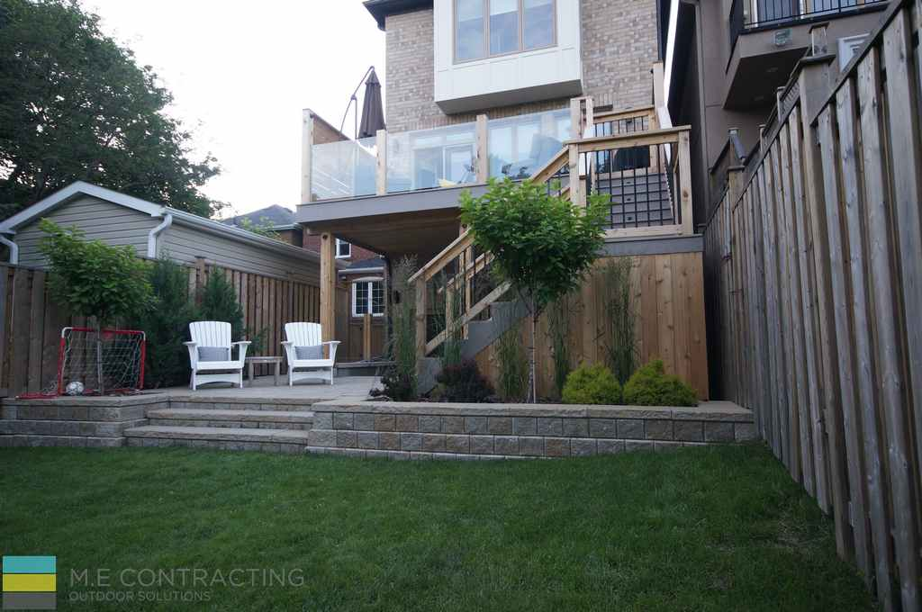 Basement walkout, interlocking, PVC deck, tempered glass railings, aluminum railings, storage space, retaining wall, landscaping, privacy screen