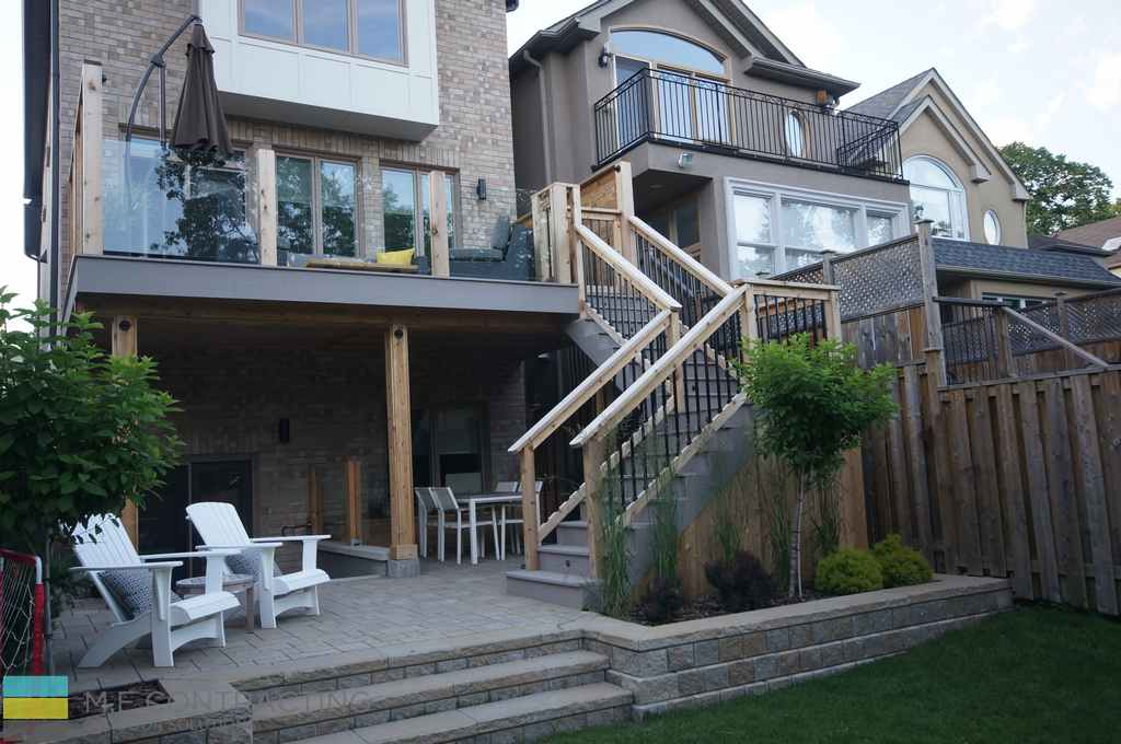 Basement walkout, interlocking, PVC deck, tempered glass railings, aluminum railings, storage space, retaining wall, landscaping